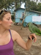 Casually hanging out with a bird in the middle of an Amerindian village