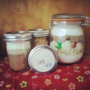 Christmas hamper items L-R- Hot cocoa mix, spiced cous cous, Xmas cowgirl cookies. Front- home made peanut butter!